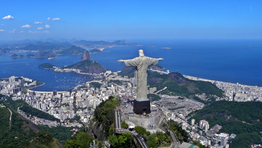 Aerial photo of Rio with Christ the Redeemer statue in foreground