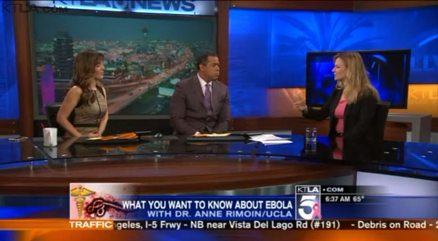 Dr. Anne Rimion sitting at the KTLA news desk with two anchors