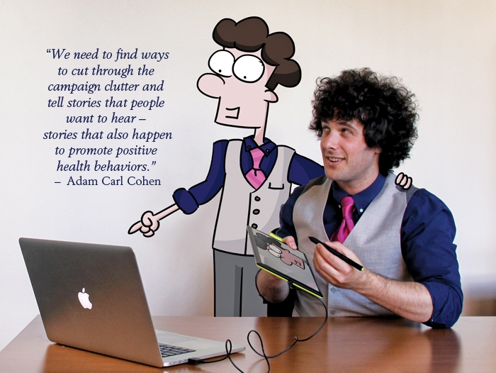 A young man, Adam Carl Cohen, with his animated character looking at a computer.