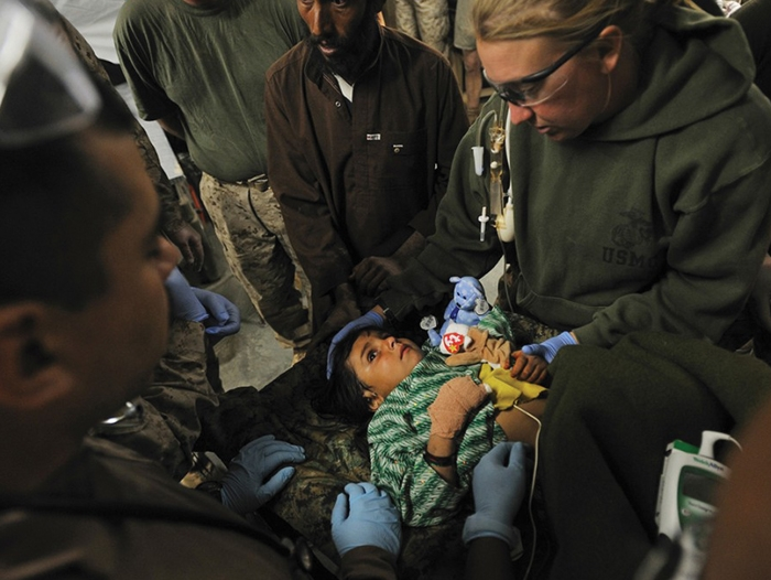 U.S. Navy nurse Amy Zaycek treats a small child during her deployment to Afghanistan.