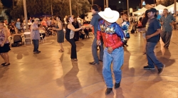 A group of people dancing in the hispanic community of Boyle Heights.