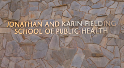 "Stone wall with gold words: ""Jonathan and Karin Fielding School of Public Health"""