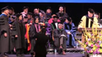 Doctoral candidate hooding ceremony.