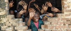 children waving and smiling