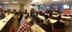 a panoramic photo of a group of people being trained at a Health DATA workshop.