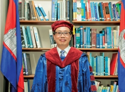 SAPHONN AT THE 2010 G R ADUATIO N CEREMONY FOR THE SCHOOL OF PUBLIC HEALTH HE FOUNDED AT CAMBODIA'S NATIONAL  INSTITUTE OF PUBLIC HEALTH