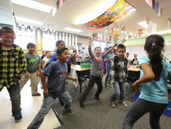 Children participating in Instant Recess in the classroom at Green Elementary School.