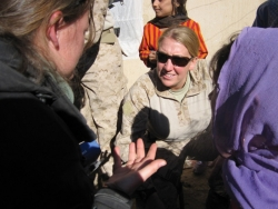 A young woman, Amy Zaycek speaks with another woman in Now Zad, Afghanistan.
