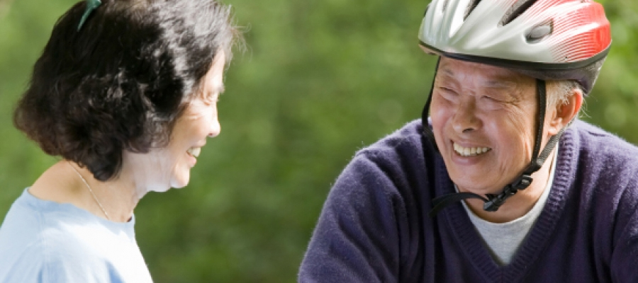 smiling man wearing a bike helmet and smiling woman