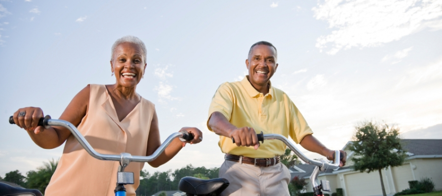 older couple smiling with bikes