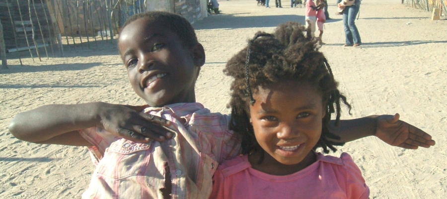 2 kids smiling in a South African township