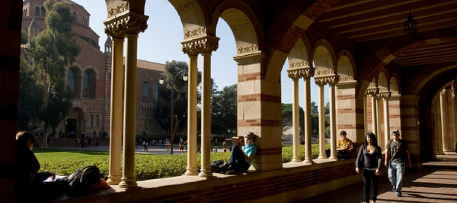 view of UCLA Powell Library from under arches