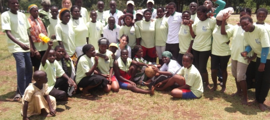 Ashley Avella with a group of people in Uganda