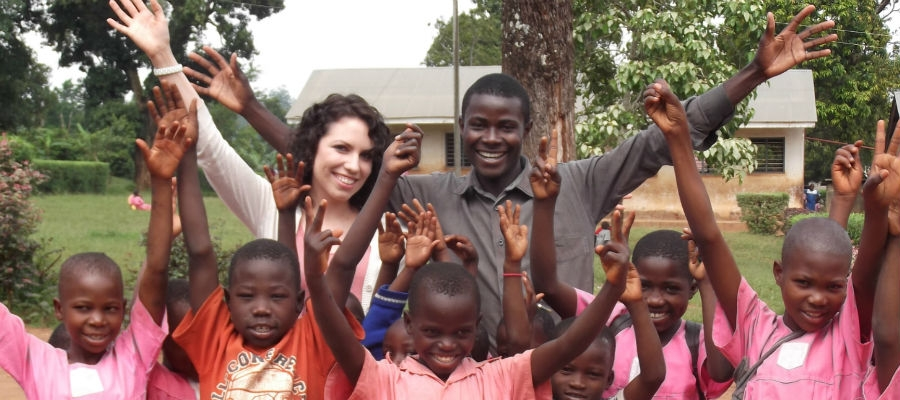 Ashley Avella with children in Uganda