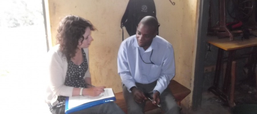 Ashley Avella speaking with a man in Uganda