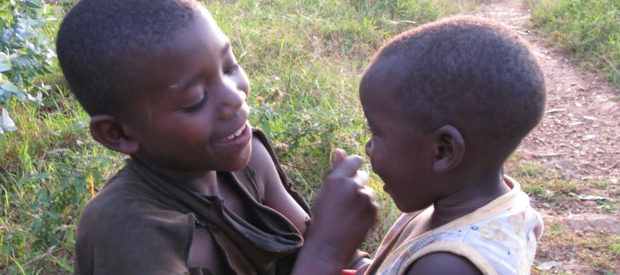 Rwandan boy playing with younger sibling