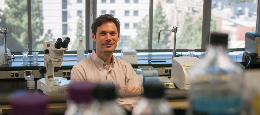 Patrick Allard sitting in his laboratory