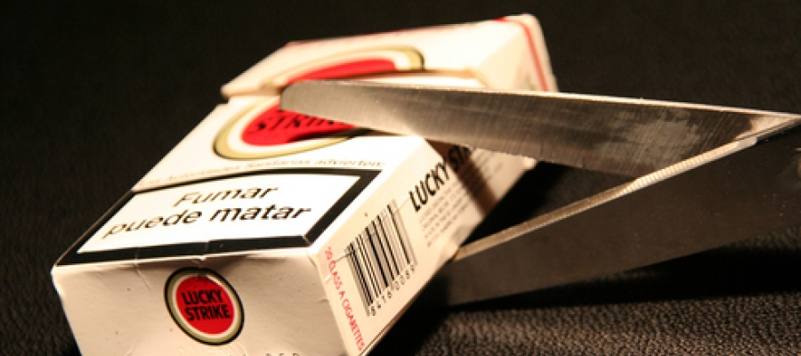 Image of a pack of cigarettes being cut in half