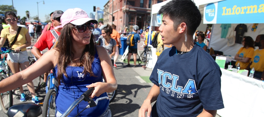 Young woman and man conversing at CicLAvia