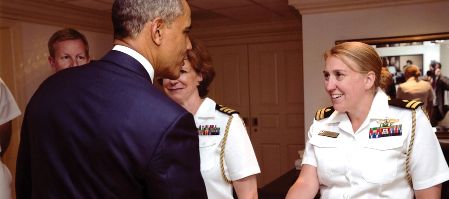 Student Amy Zaycek shaking hands with President Obama