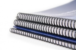 stack of spiral bound publications